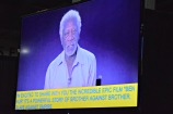 Morgan Freeman speaks on screen, open captions below