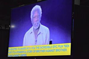 Morgan Freeman speaks on screen, open captions below
