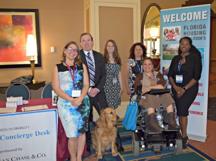 Six people with varied disabilities and one service dog