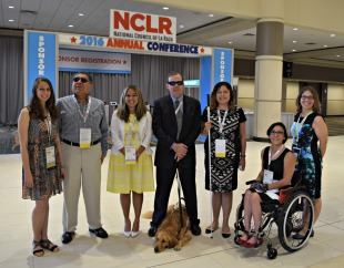 Seven people with varied disabilities and one service dog