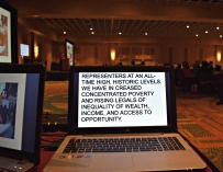 A laptop displays captioning