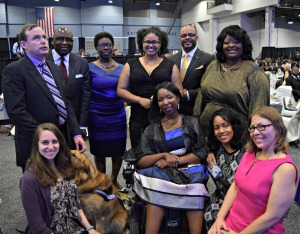 Ten people with varied disabilities and one service dog