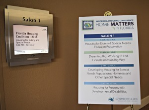 A sign in front of Salon 1 lists several disability-focused sessions