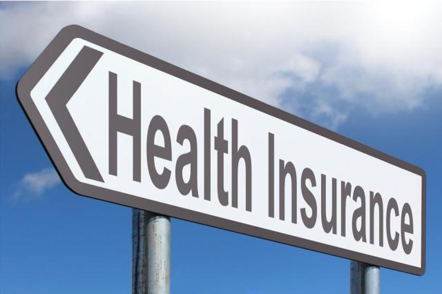 "A close up of a sign that reads ""health insurance"""