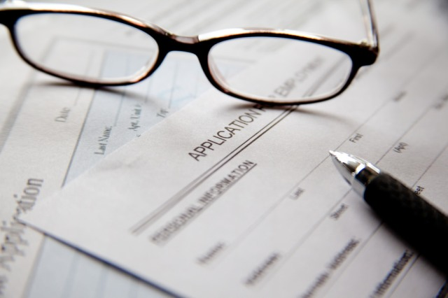 Link to Job Announcement: Employment and Disability Benefits Initiative (EDBI) Manager article; image of a blank application, a pair of glasses, and a pen
