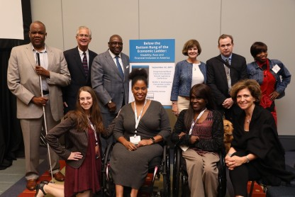A group of ten people, some with disabilities, and one service dog