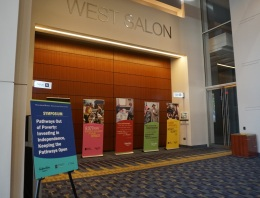 Five pop-up banners describe the day's symposium and some core values of NeighborWorks America