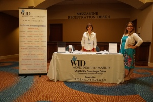 Two women stand near the Disability Concierge Desk