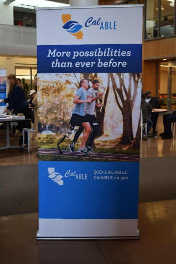 "Tall banner says ""CalABLE: More possibilities than ever before"" Photo of two runners, one with a lower limb prosthesis. CalABLE website and phone number."