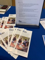 Pamphlets and flyers with WID logo on blue tablecloth