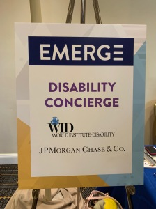 """Poster on easel. """"Emerge Disability Concierge: World Institute on Disability & JP Morgan & Chase"""