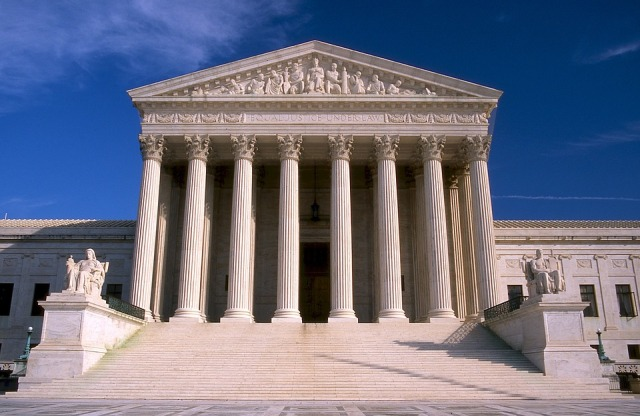 Front of US Supreme Court building, with intimidating stone columns and steps.