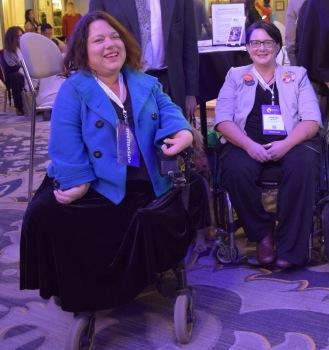 2 women in wheelchairs smiling
