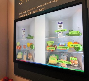 Screen showing grocery items in fridge, labeled using smart recognition technology.
