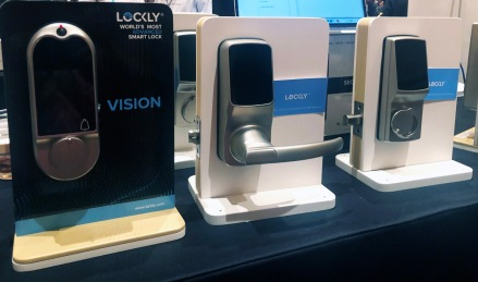 3 demo versions of the Lockly advanced smart locks for doors. Each is stainless steel with a digital screen.