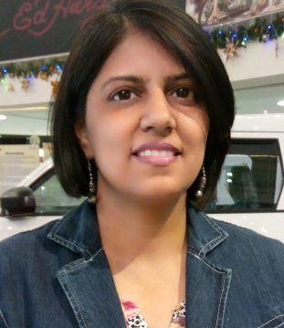 Author photo of an Indian woman with chin length dark hair. She is smiling.