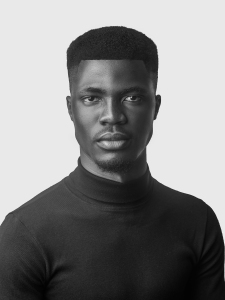 Portrait photo of Obafemi Thanni, a Black man wearing a black turtleneck sweater.